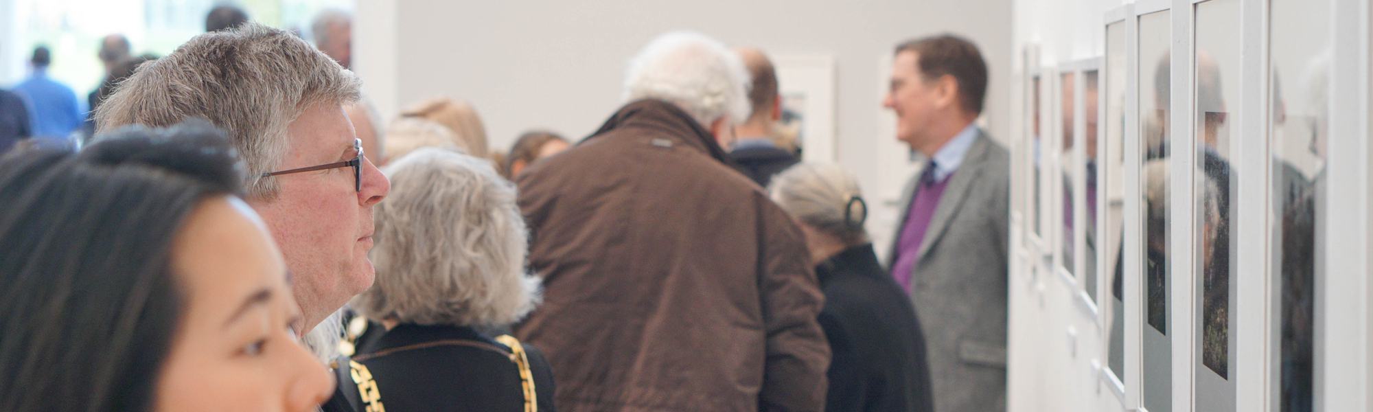 Visitors looking at art in an exhibition